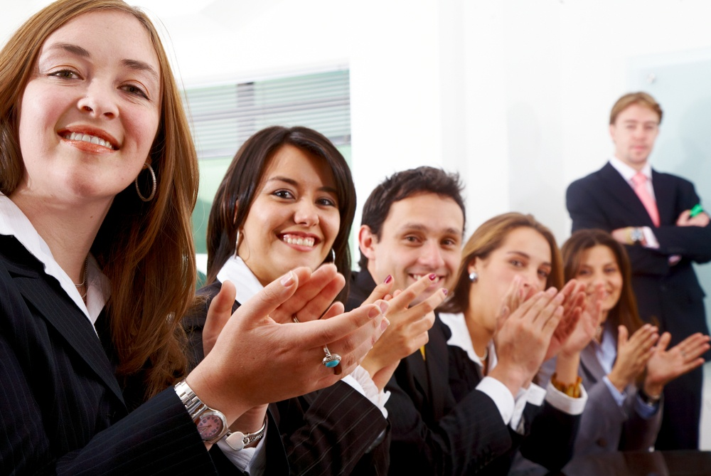 business team clapping a good presentation in an office-1.jpeg